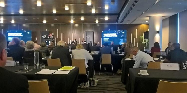 [Photo: KNZ President Dennis May, NZOC Function, KNZ Secretary-General Chris Bennett with members of NZOC]