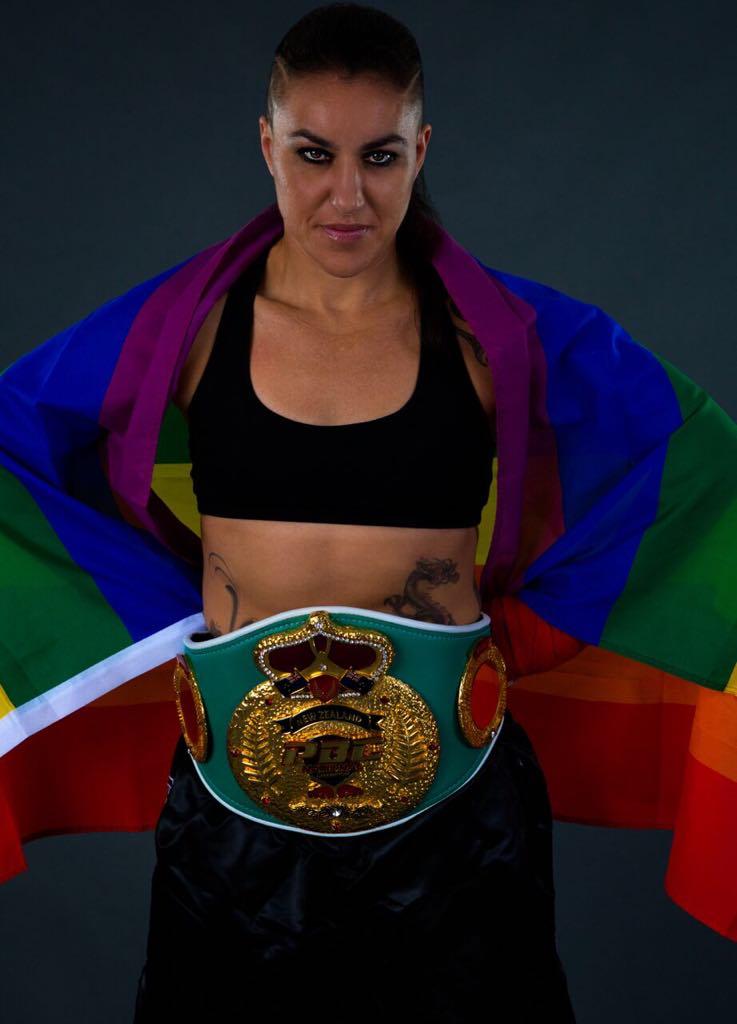 Geovana Peres flies the rainbow flag. Photo courtesy of Linda Keim.