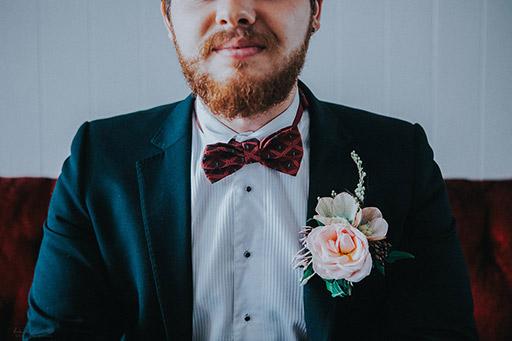 BoutiqueBarn-41rose-rustic-buttonhol-wedding-groom.jpg