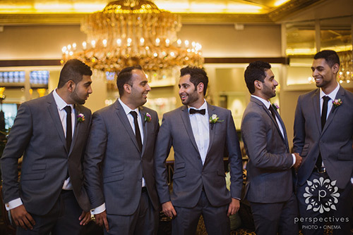 groom-groomsmen-wedding-suits-buttonholes.jpg