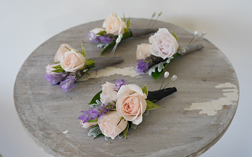 peach-rose-lavender-buttonhole-groom-wedding.jpg
