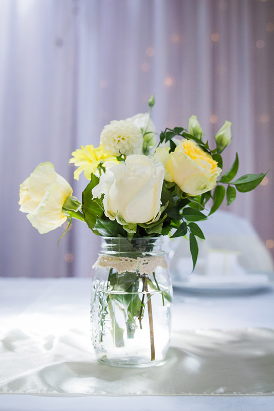 yellow-jar-flowers-centrepiece-auckland.jpg