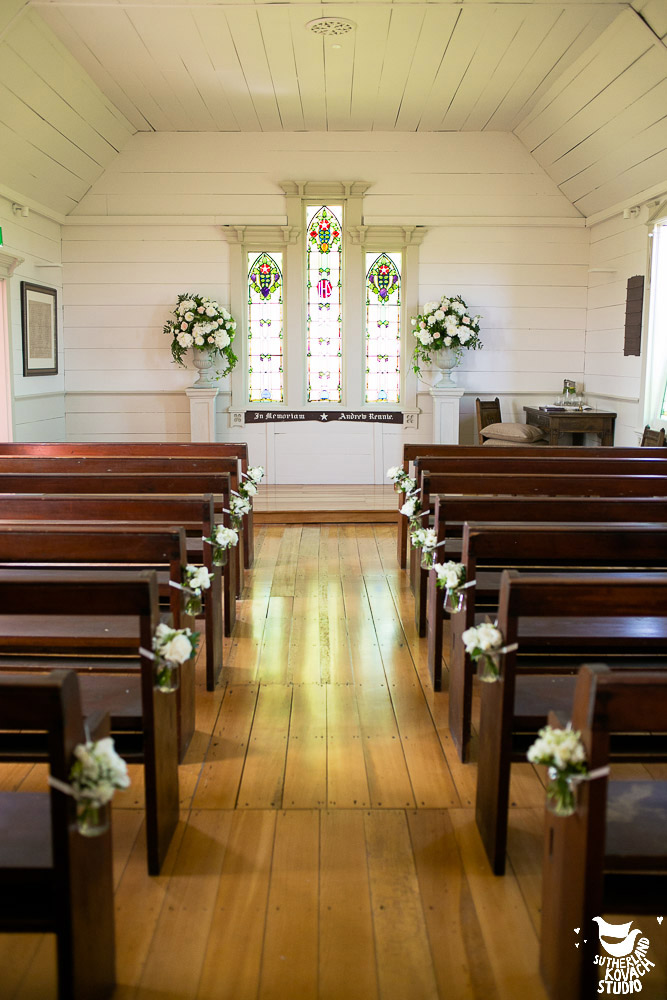 wedding ceremony flowers urns aisle flowers jars chapel auckland