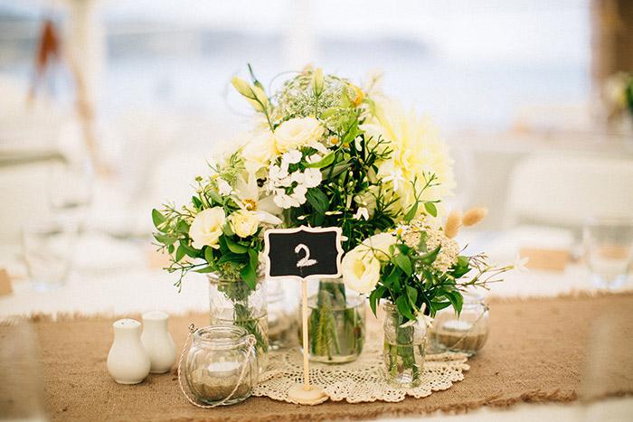 white-yellow-beach-hessian-centrepiece-wedding-auckland.jpg