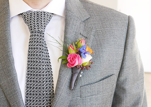 pink-blue-colourful-buttonhole-wedding-groom-flowers.jpg