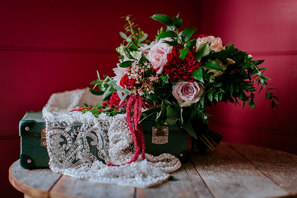 Maroon Dahlia and Blush Roses with lush greenery. Captured by  Soul Sisters Photography