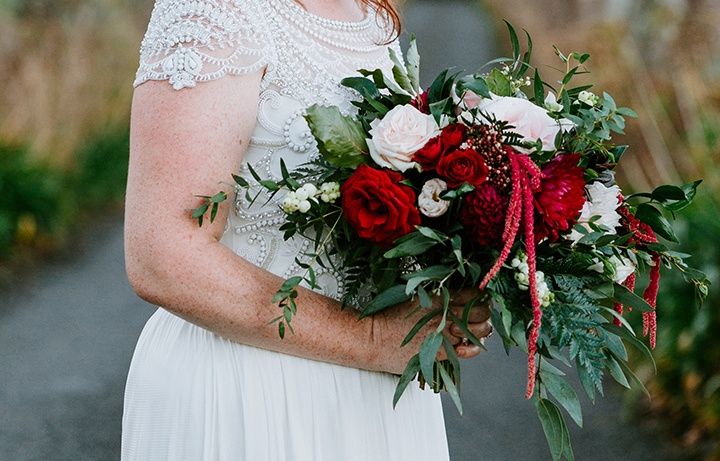 Maroon Dahlia and Blush Roses with lush greenery. Captured by  Soul Sisters Photography.