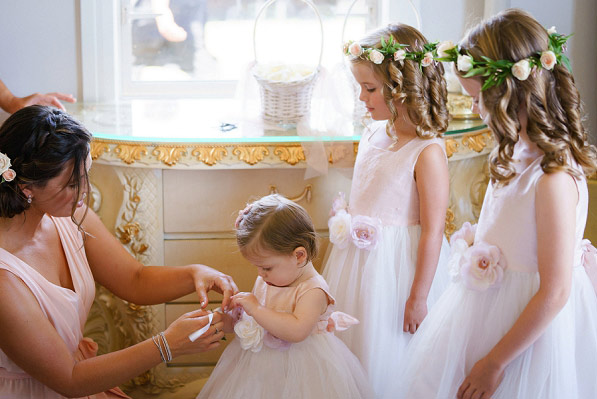 Flower girl circlets with blush peach roses and jasmine. Captured by  Tony Mckay Studios