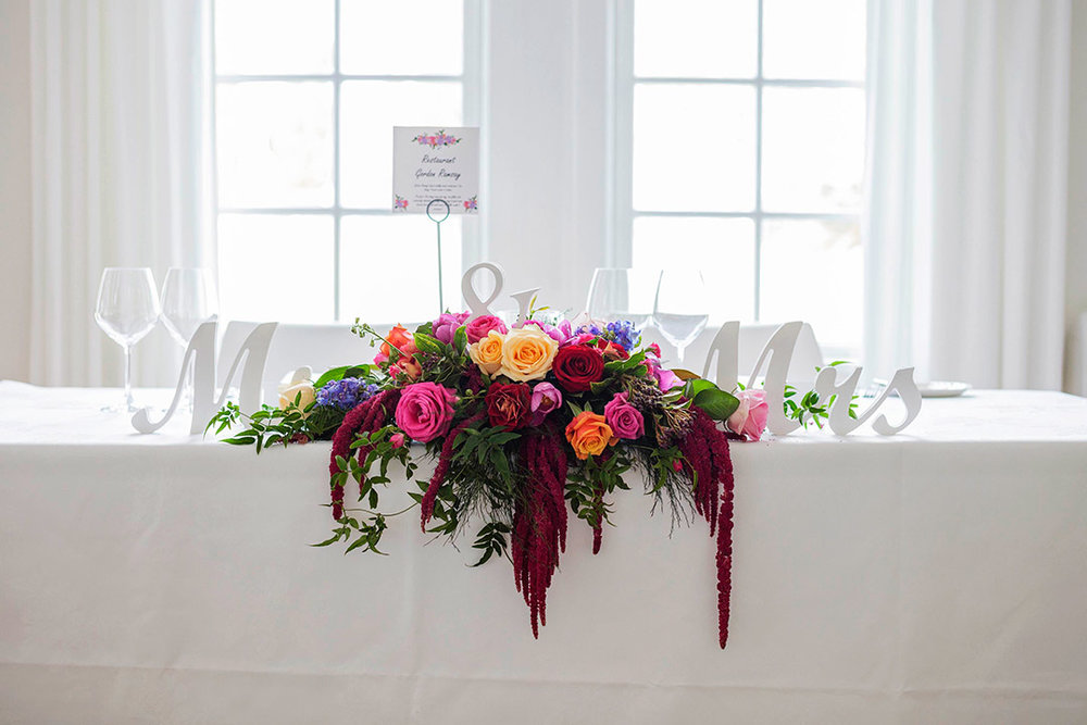 head-table-flowers-colourful-wedding-auckland.jpg