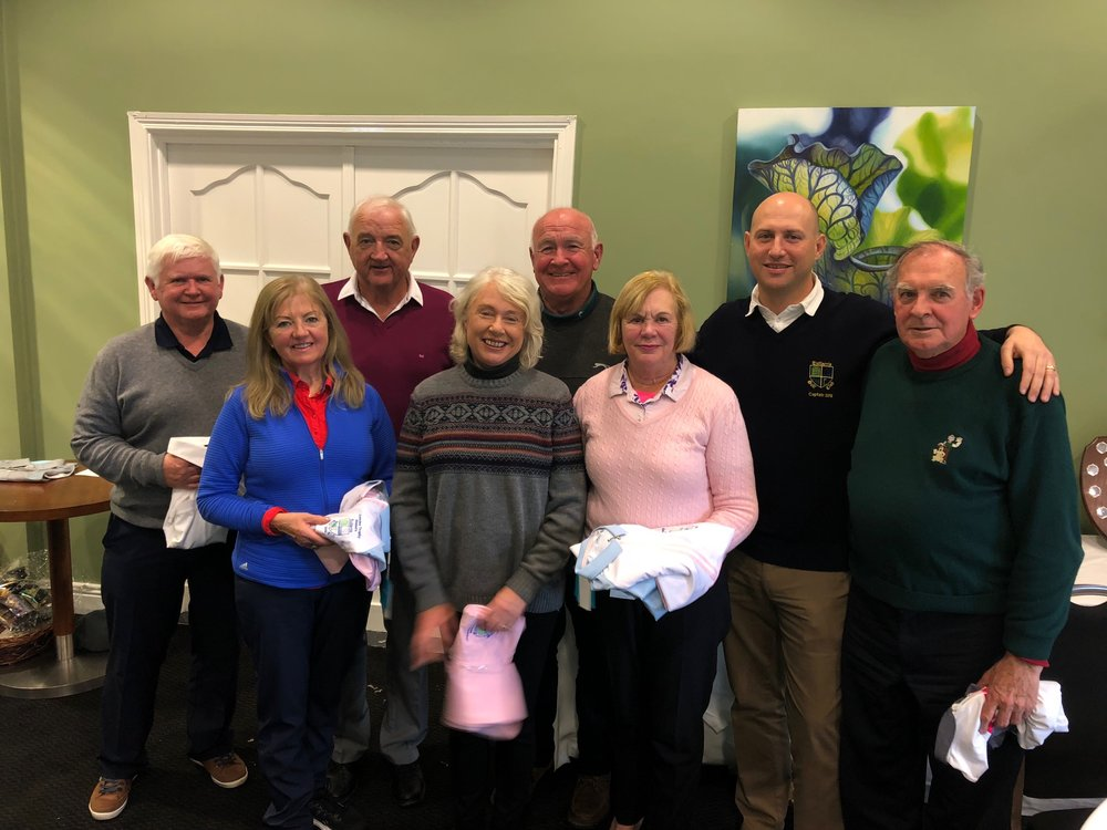 Capt Shemus Dore presenting our victorious side with winners shirts.  John Curley, Mary Curley, John Horan, Miriam Solan, Gerry Solan, Ann Horan, Shemus Dore & Noel Reilly. ( Absent Rosaleen Prescott)