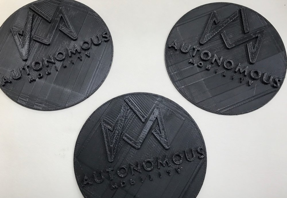 3D-printed logos for the rims.