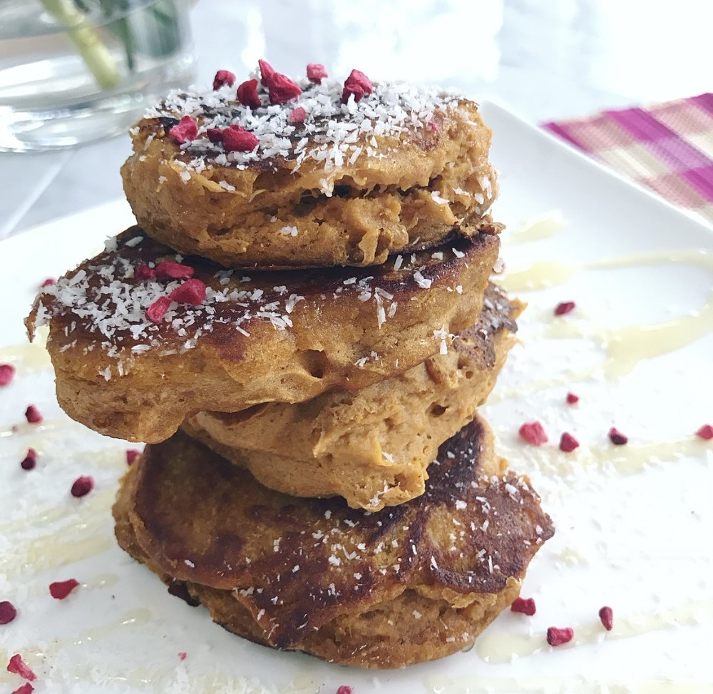 Ingredients:  2 medium sweet potatoes (roasted for 1 hour 15 minutes at 180 °C, left to cooled and peeled) 1 egg 1 tsp vanilla extract (avoid ones with added sugar) 1 tbsp almond milk (or any other of your choice) 1/2 cup buckwheat flour 1/4 tsp bicarbonate of soda 1/2 tsp cinnamon 1/2 tsp mixed spice  honey to taste (optional)  Coconut oil for cooking  Method:  1. Peel and mash the sweet potatoes, they should be extremely soft. 2. Add the egg, vanilla extract,almond milk and honey (if using) and combine until smooth. 3. Mix all the dry ingredients in a bowl and then pour the dry ingredients into the wet ingredients and mix until well combined. You are looking for a wet dough texture (thicker than a normal pancake - you may need to add more milk to achieve this). 4. Heat a pan with coconut oil and spoon the mix into the pan, flattening the top where possible (this will be very thick though so don't worry). 5. Cook for 4-5 minutes over a medium heat and then flip and cook for another 2-3 minutes. Be careful not to let them burn. 6. Repeat with the whole mixture, stack up and serve.  Optional toppings: desiccated coconut, honey, maple syrup, berries, banana, cacao nibs.