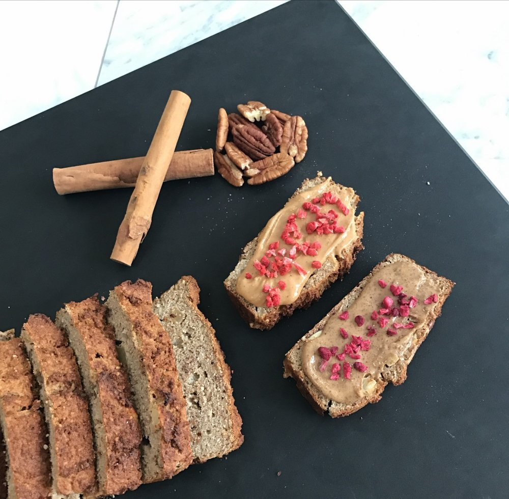 Ingredients:  5 eggs 200g apple sauce 1 tsp vanilla extract 50g almond butter  1 tbsp melted coconut oil honey (optional) - this is a loaf recipe so be aware it isn't naturally sweet 100g ground almonds 60g coconut flour 1/2 tsp bicarbonate of soda 1/2 tsp baking powder 2 tsp ground cinnamon 1/2 tsp allspice 1/4 tsp nutmeg 2 tbsp dairy free milk 1 apple (peeled, cored and chopped) 30g pecans (chopped)  Method:  1. Preheat the oven to 180°C. 2. In a bowl mix the eggs, apple sauce, vanilla extract, almond butter, coconut oil and honey (if using) until well combined. 3. Add the ground almonds, coconut flour, bicarbonate of soda, baking powder, cinnamon, allspice and nutmeg). Mix until well combined. 4. Slowly pour in the dairy free milk until the mixture has loosened a little. You're looking for a soft spoon-able mix (it shouldn't be super runny). 5. Fold in the apple and pecans and transfer into a lined loaf tin. 6. Place in the oven and bake for 40-50 minutes (check on it after 40 it may only need another 5). 7. Remove from the oven and allow to cool completely before slicing up to serve. Best served with nut butter!