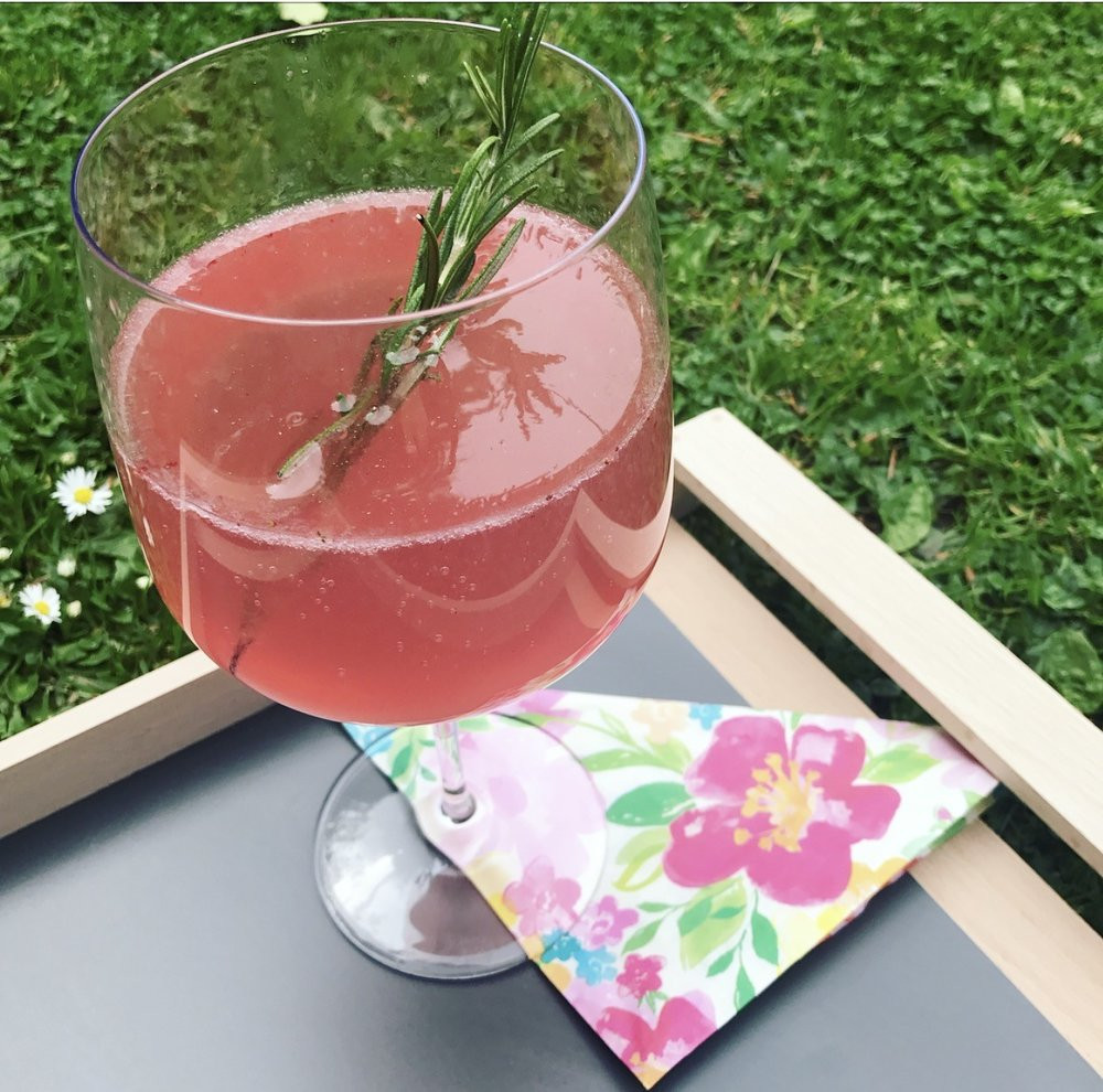 Ingredients:   200ml raw coconut water (raw coconut water is a little sweeter) 2 handfuls of raspberries  Juice 1/2 lime 200ml  sparkling water Sprig of rosemary Honey optional Ice (optional)     Method:  1. Muddle the raspberries (and honey if using) in a glass with 100ml of coconut water.  2. Strain the berries into a separate glass and pour in the lime juice,  remaining of the coconut water and sparkling water.  3. Place the rosemary into the glass.  4. Add ice if desired and enjoy!