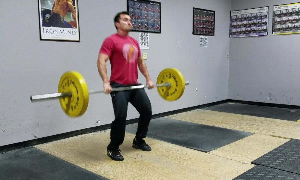 Sweep/scoop the bar back into the power position to clean it up to the shoulders.