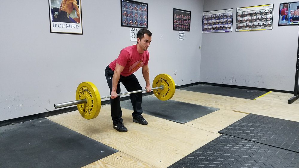 Push your knees back to stay over the bar.