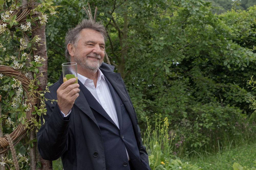 Raymond Blanc enjoying a quick drink in the Belmond Enchanted Garden.
