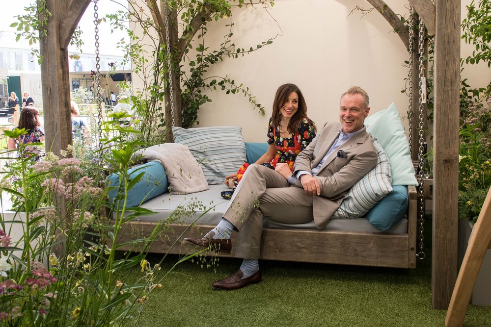 Gary Kemp and his wife Lauren relax on the newly launched day bed by Sitting Spiritually at this years Chelsea Flower Show