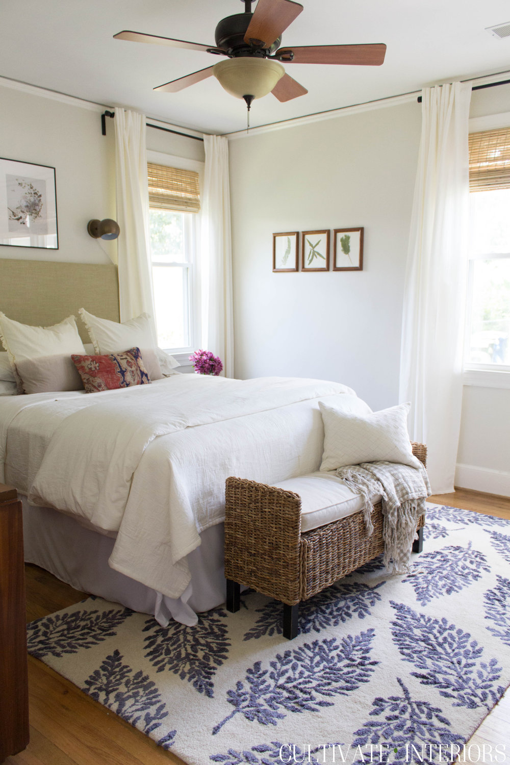 Eclectic natural bedroom with pressed botanicals, kilim pillow, and light and bright feel