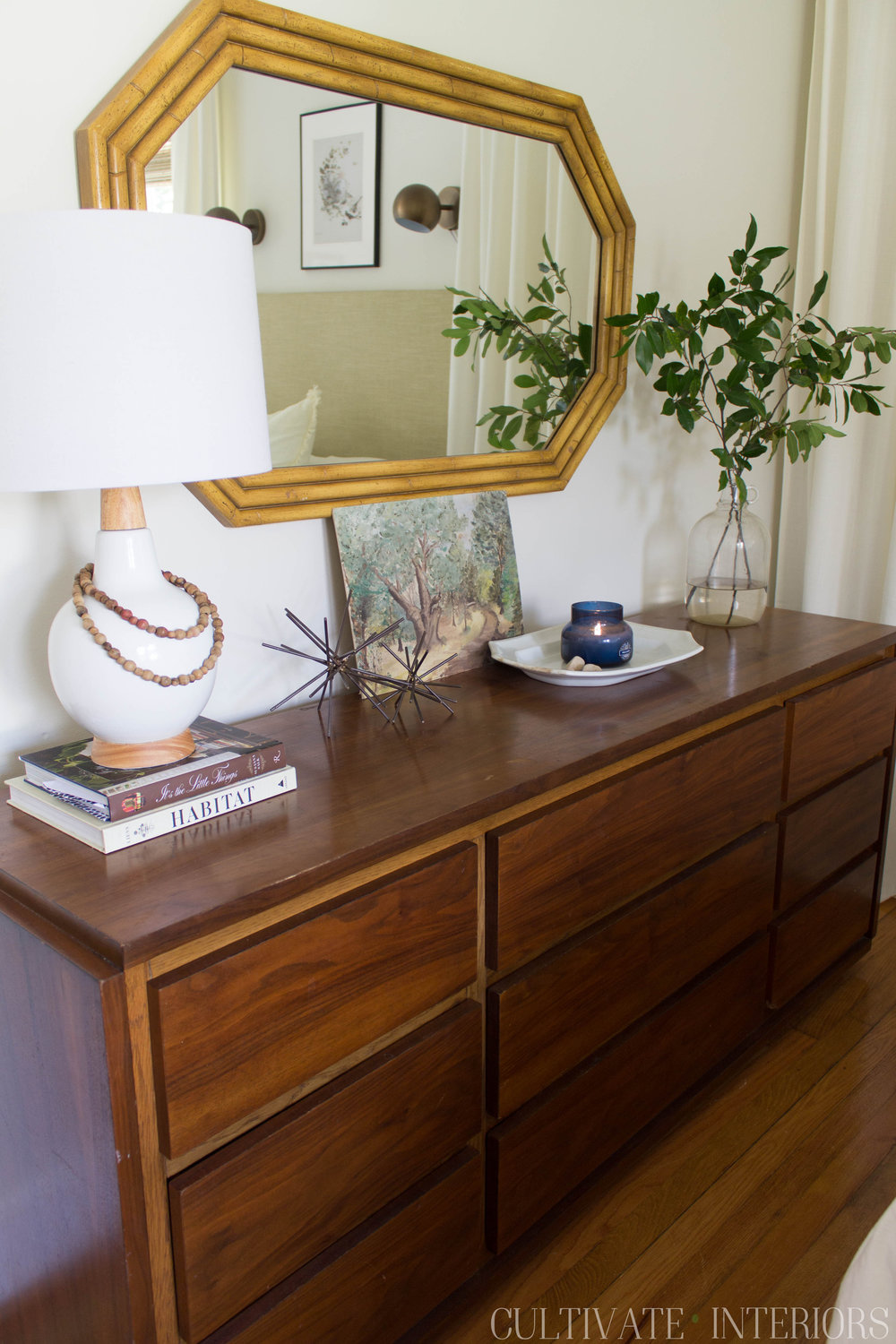 Mid century modern wood dresser with voluspa candle and thrifted, eclectic accessories