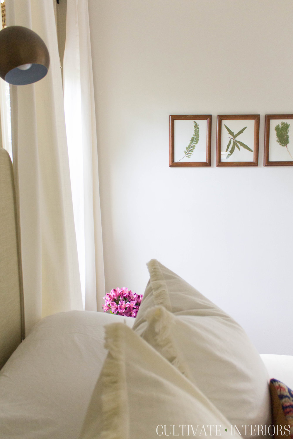 Eclectic natural bedroom with DIY pressed botanical art