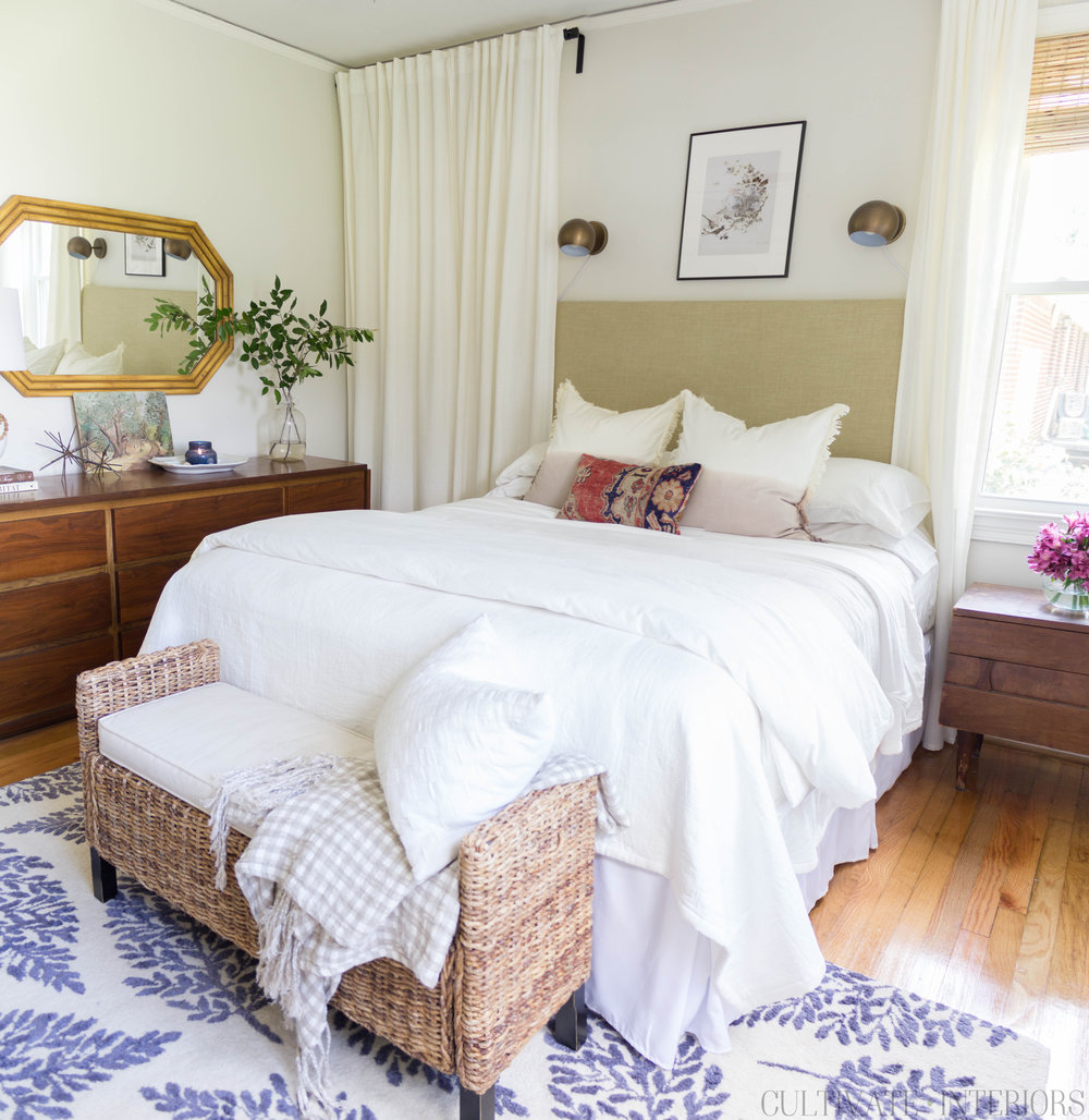 Eclectic bright natural bedroom with white walls