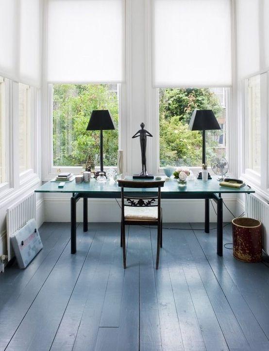 Blue painted floor boards via