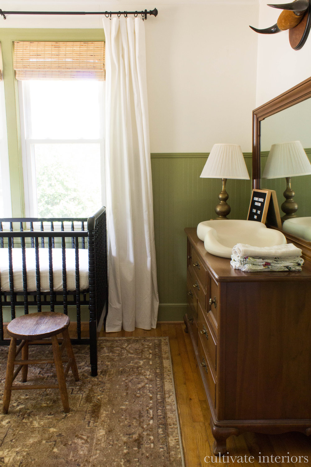 My  best friend's nursery , where we mixed her husband's grandmother's inherited dresser with a new rug + inexpensive crib.