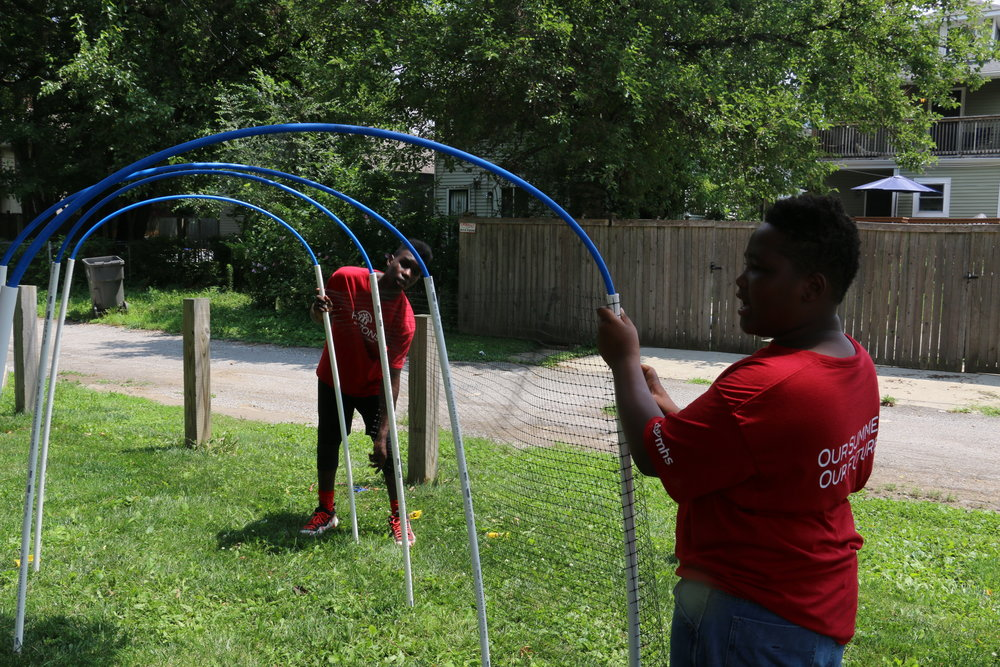 James and Kevon assemble the hoop house structure for Tunnel Vision.