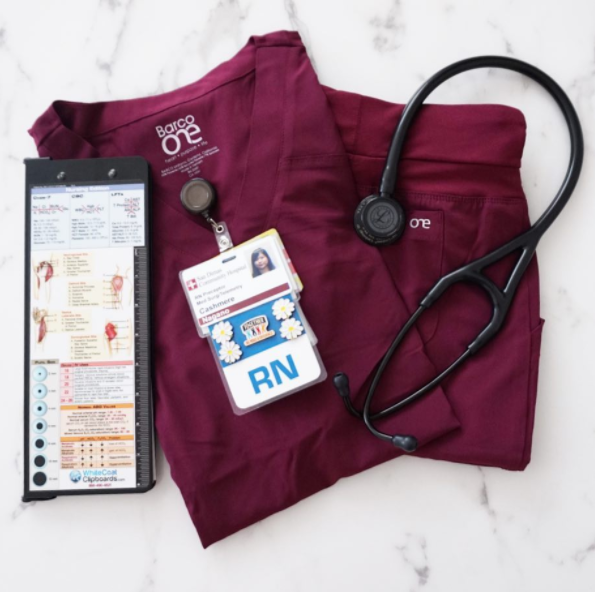 #RealCaregivers: @merelycash - I received the prettiest 🍷 color of #barcoone scrubs yesterday from my friends at @barco.uniforms and I love that it matches my badge too! 💃🏻 Also- Many of you already know how much I love my @mdpocketwcc (7+ years now) but I'm excited to try out this vertical version in which I've created a new nursing sbar/brain for. 👩🏻‍⚕️ See my stories to see more. 🤗