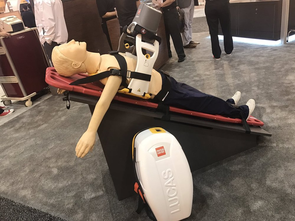 Dr Sam with CPR machine.jpg