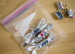 This simple DIY hack is incredibly efficient - and cheap! Take your cords and wrap them with a binder clip, then place them all in a sandwich or gallon size zip lock depending on your needs.