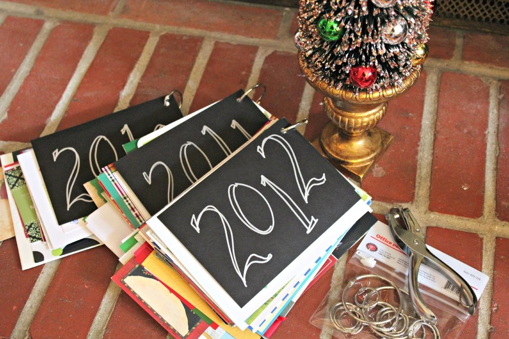 All you need is a hold punch, a bag of clasp rings (you can get them at any craft or office store) and your selected greetings. These are great to lay on the coffee table each holiday season, and so fun to look through!