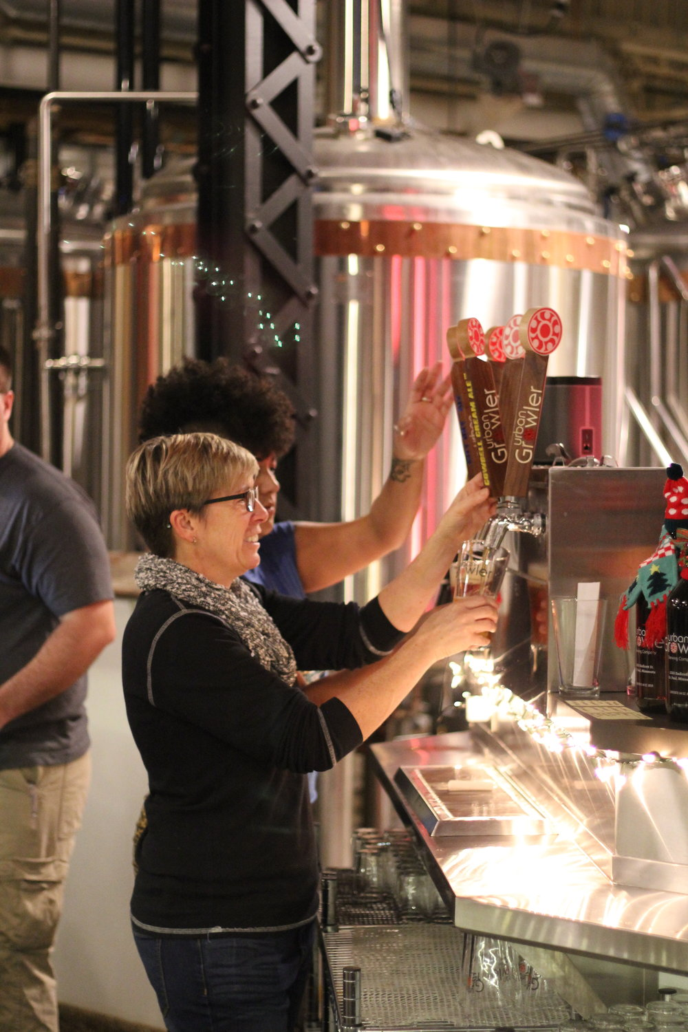 Jill Pavlak, co-owner of Urban Growler, pouring a Cream Ale