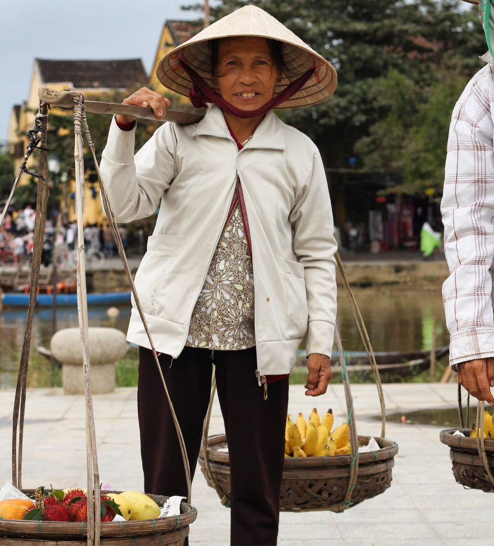 A friendly and persistent fruit seller in Hoi An.