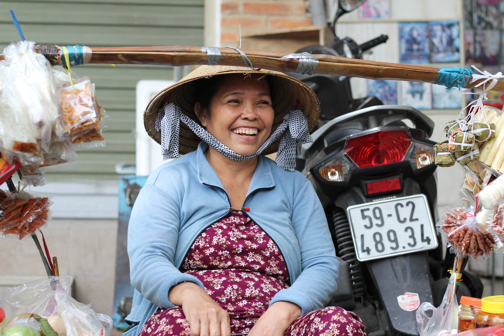 A friendly street vendor, saving me from my afternoon hunger in Ho Chi Minh City.