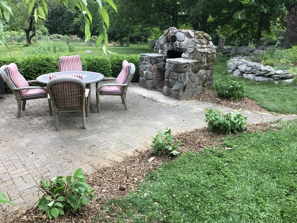 Patio with outdoor fireplace that is available for guests