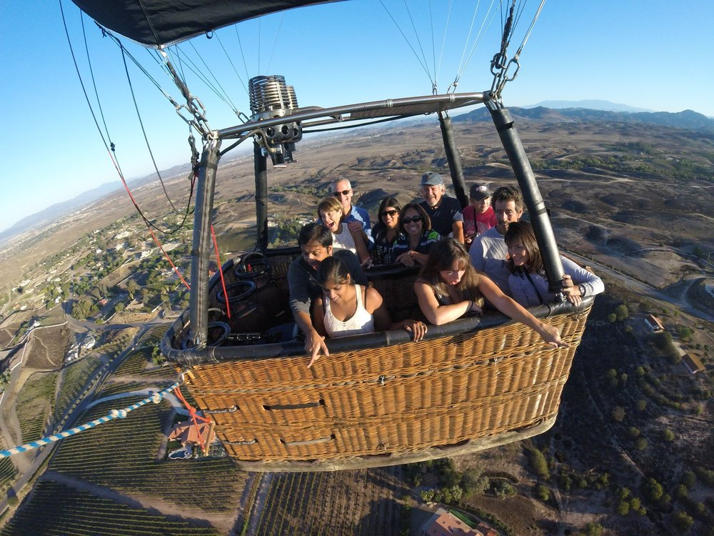 group of people flying in a hot air balloon