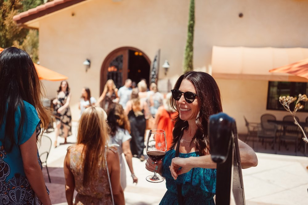 woman-tasting-wine-at-winery