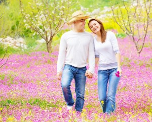 Couple walking in flowers