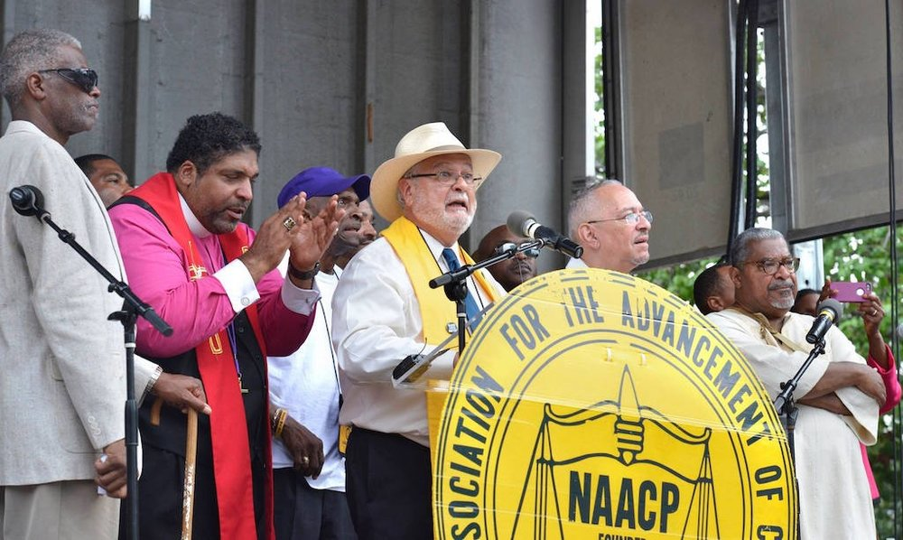 UUA President, Rev. Peter Morales at Moral Monday event with Rev. Dr. William J Barber II (photo copyright Nancy Pierce/UUA)