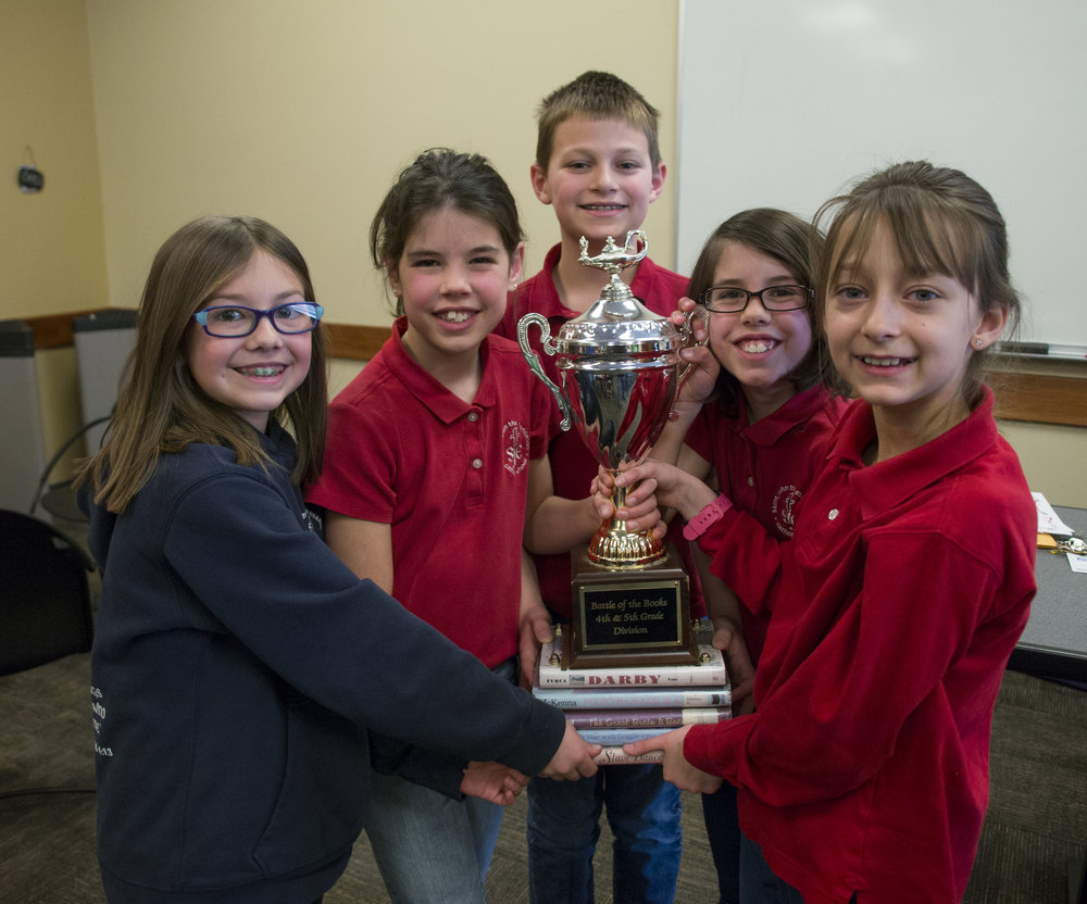 4th Grade Battle of the Books Team with the Championship Trophy.
