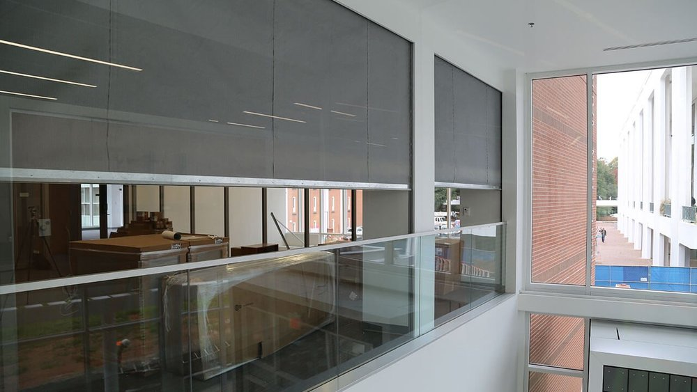 m2100 - This vertically deploying fire and smoke rated curtain is an economical choice for openings. This solution works well for atrium separation, openings in walls, and for specialty enclosures where fire-rated protection is required in areas which do not require egress in an emergency.