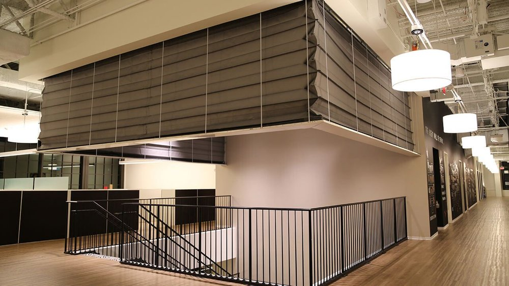 m4000 - Smoke Guard's  M4000 fire-rated curtain is the ideal solution for vertically deploying perimeter curtain installations, and does not require corner support posts. This type of fire curtain can shield staircases or escalators from smoke and flames, or provide a reservoir for smoke on the upper floors of an atrium or other open space. While the M4000 does not provide gaps for egress, it can be an effective complement to existing mechanical smoke and fire containment systems or additional fire curtains.