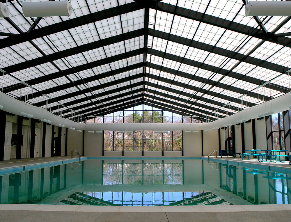 STRUCTURES UNLIMITED DAYLIGHTING - Our unique total building systems for structural skylights, skyroofs, pool enclosures and canopies/walkways offer a pre-engineered box beam system that can span areas in excess of 100 feet, while providing a clean, finished appearance that is virtually maintenance-free, energy efficient and highly corrosion resistant. Ideal for LEED projects, high winds, and snow loads.