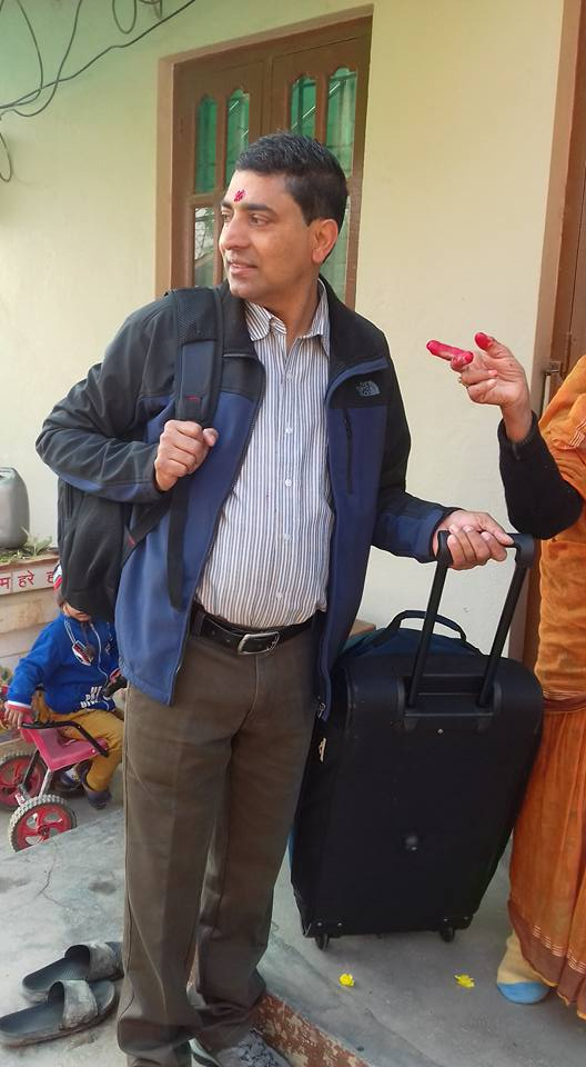 Murari making his farewells to his family before leaving home.  Have suitcase will travel!!!