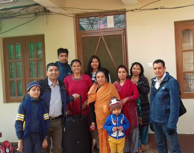 Murari with his wife and family before setting off for the airport and the UK
