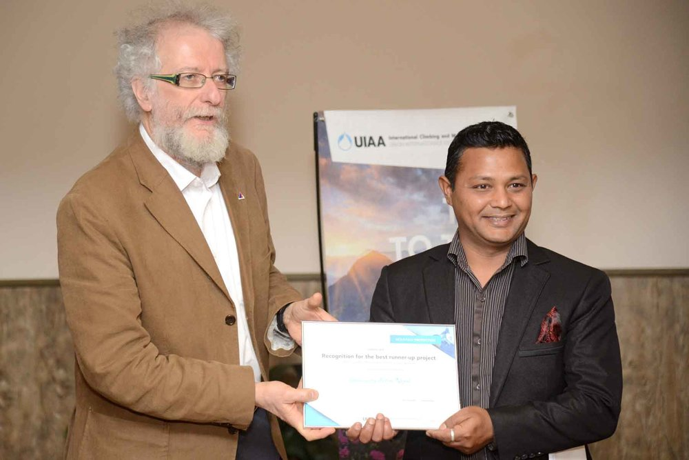 Sanjeev receiving the UIAA Award from Mr Pier Giorgio Oliveti, UIAA Board Member, who joined the Board in place of retiring Board Member, Doug Scott.