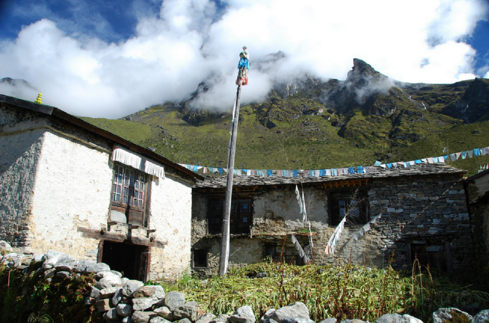 The Sherpa Heritage House and Gompa (on the left hand side of the picture) before restoration