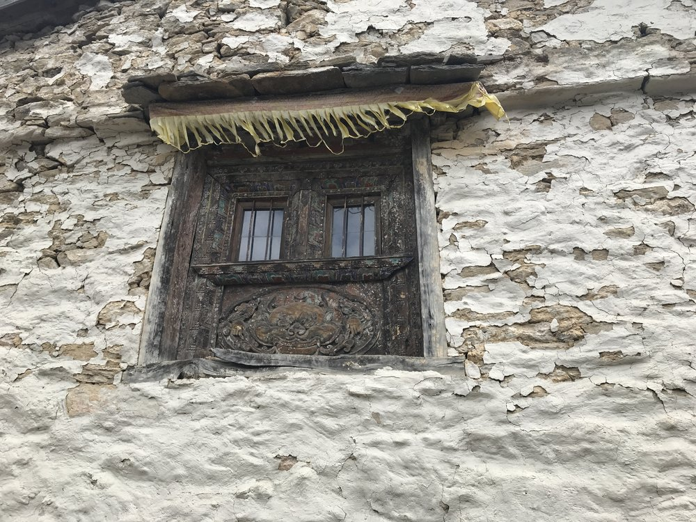 Window frame showing traditional carving